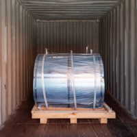 Steel cylinder in container
